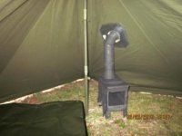 F with the stove fed regularly. The stove jack is a piece of aluminum flashing with a pre-cut hole sewn into the side of shelter. Here are some pics. & Heated us gi pup tent/ ammo can stove | Bushcraft USA Forums