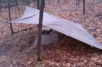 Here is the tarp setup in typical lean fashion with the watchcoat laid down for a piece of ground cover. Which is my plan for it as well as being used as ... & Configurations with Tentsmiths oilskin trail tarp | Bushcraft USA Forums